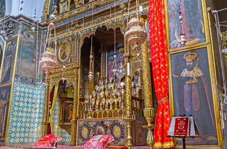 relics: JERUSALEM, ISRAEL - FEBRUARY 16, 2016:  The central altar and iconostasis in St James Cathedral, decorated with the complex wooden carvings and medieval icons, contains the holy relics, on February 16 in Jerusalem.