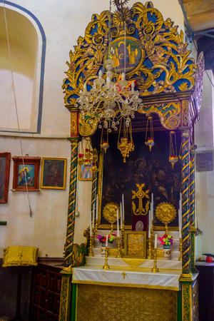 interrior: BETHLEHEM, PALESTINE - FEBRUARY 18, 2016: The old icon to Madonna and the child inside the Church of the Nativity, on February 18 in Bethlehem. Editorial