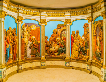 bible altar: BETHLEHEM, PALESTINE - FEBRUARY 18, 2016: The beautiful tableau with Bible scenes, located in altar, on February 18 in Bethlehem.
