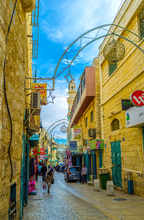 manger: BETHLEHEM, PALESTINE - FEBRUARY 18, 2016: The Pope Paul IV is the main pedestrian street that connects Manger Square with local market, on February 18 in Bethlehem.