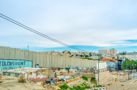 bethlehem: BETHLEHEM, PALESTINE - FEBRUARY 18, 2016: The refugee camp of palestinians under the separation wall, on February 18 in Bethlehem.