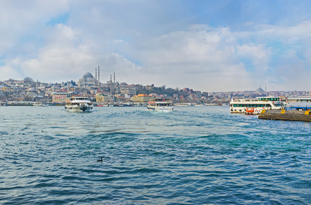 ferries: ISTANBUL, TURKEY - JANUARY 21, 2015: The cityscape of Istanbul from Galata vridge with many ferries, connecting the different banks, on January 21 in Istanbul.