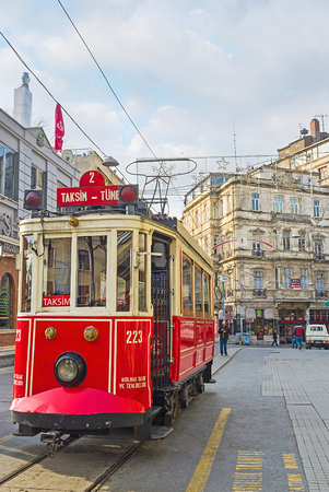 best way: ISTANBUL, TURKEY - JANUARY 21, 2015: The ride on the retro tram is the best way to discover the long Independence Avenue and enjoy the attraction, on January 21 in Istanbul.