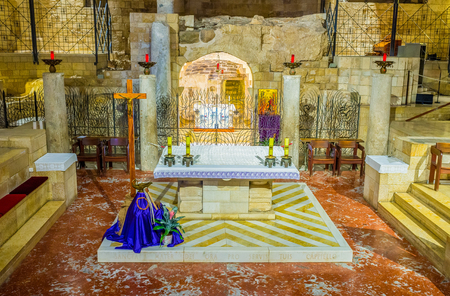 bible altar: NAZARETH, ISRAEL - FEBRUARY 21, 2016: The grotto of the Annunciation with altar in the lower level of the Basilica of Annunciation, on February 21 in Nazareth.