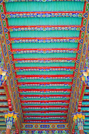 architectural feature: KOKAND, UZBEKISTAN - MAY 6, 2015: The colorful decorative elements are the architectural feature of the Uzbek mansions and palaces, such as Khudayar Khan Palace, on May 6 in Kokand.