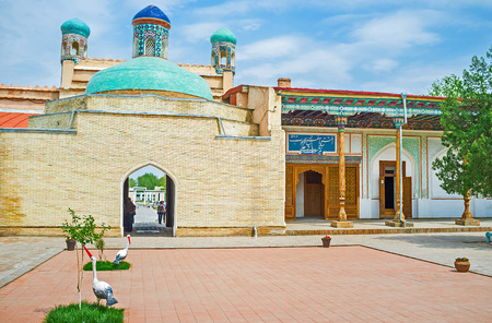 KOKAND, UZBEKISTAN - MAY 6, 2015: The main gate of Khudayar Khan Palace is topped with the bright green dome, covered with the glazed tiles, on May 6 in Kokand.