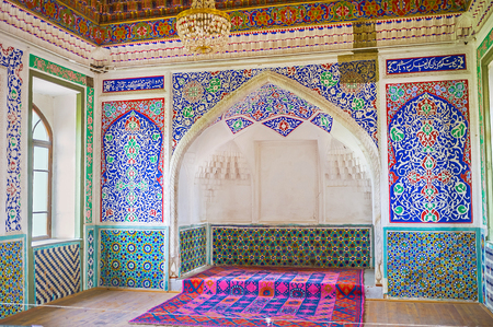 KOKAND, UZBEKISTAN - MAY 6, 2015: The interior of the Great Throne Room in Khudayar Khan Palace with the carved and painted patterns on the walls, on May 6 in Kokand.