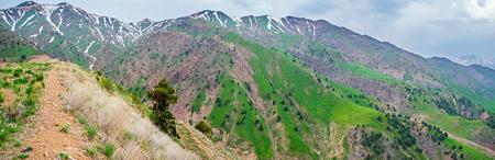 adjacent: The pleasant walk in Qurama Mountains, adjacent to the Kamchik Peak, Uzbekistan.