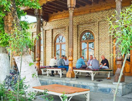 teahouse: KOKAND, UZBEKISTAN - MAY 6, 2015: The locals enjoy the shady terrace of the teahouse, on May 6 in Kokand.
