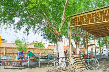 teahouse: KOKAND, UZBEKISTAN - MAY 6, 2015: The local men like to spend their free time with friends in the teahouse, on May 6 in Kokand. Editorial