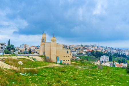 The view on the residential neighborhood with modern church Alzainit on the foreground, Nazareth, Israel.