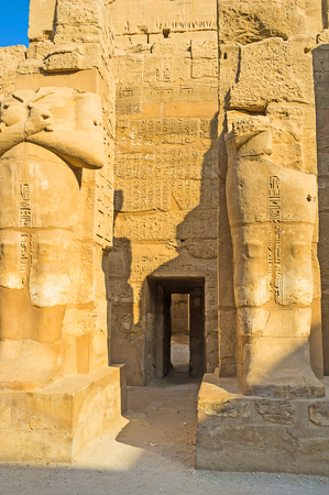 The side door in Temple of Ramesses III connects it with other buildings of Karnak & The Tiny Jib-door Between The Ruins Of The Large Mummy Statues ...