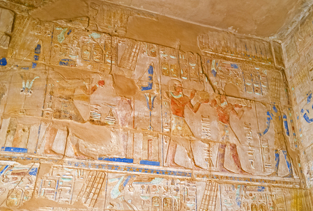 depict: The reliefs depict the traditional for Egyptian Temples scenes of Pharaohs life and mythology, on October 7 in Luxor.