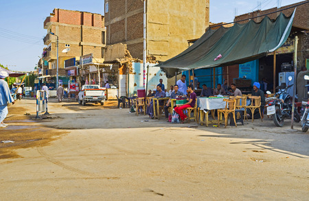 teahouse: EDFU, EGYPT - OCTOBER 7, 2014: The outdoor teahouse in a central residential district faces on the road, on October 7 in Edfu.