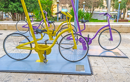 cycles: JERUSALEM, ISRAEL - FEBRUARY 18, 2016: The modern instalation in Safra Square with many colorful cycles, on February 18 in Jerusalem.