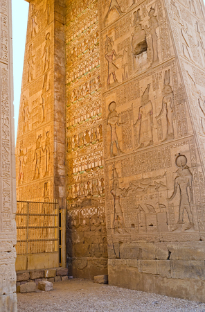 moon gate: The inner part of the entrance gate of the Khonsu Temple, decorated with the numerous ancient reliefs, depicting the myths about the God of Moon - Khonsu, Karnak Complex, Luxor, Egypt.