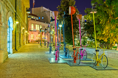 ciclos: JERUSALEM, ISRAEL - FEBRUARY 17, 2016: The urban installation in Safra Square with many cycles looks great in the evening, on February 17 in Jerusalem.