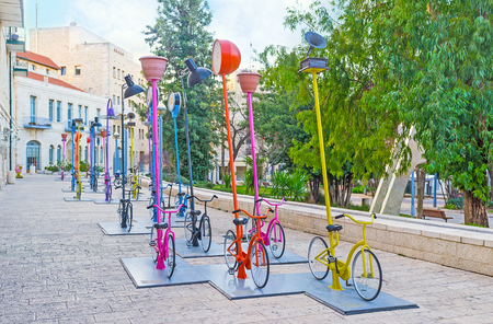 cicla: JERUSALEM, ISRAEL - FEBRUARY 18, 2016: The urban installation in Safra Square in front of the City Hall, consists of the numerous colorful cycles, on February 18 in Jerusalem. Editorial