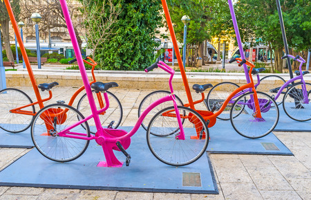 ciclos: JERUSALEM, ISRAEL - FEBRUARY 18, 2016: The urban installation in Safra Square in front of the City Hall, consists of the numerous colorful cycles, on February 18 in Jerusalem. Editorial