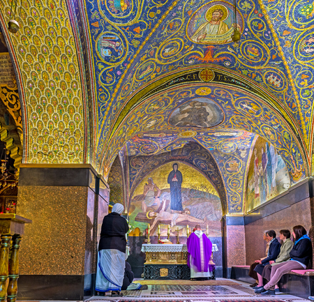 iconostasis: JERUSALEM, ISRAEL - FEBRUARY 18, 2016: The interior of the Latin Calvary Chapel in the Church of the Holy Sepulchre, decorated with the colorful mosaic patterns and icons, on February 18 in Jerusalem.