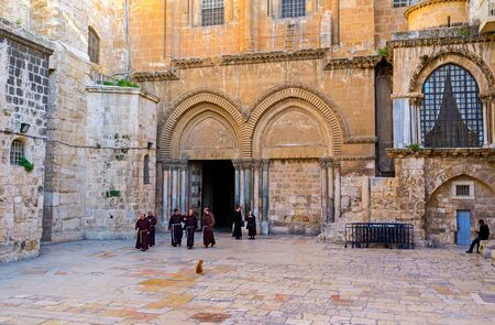 franciscan: JERUSALEM, ISRAEL - FEBRUARY 18, 2016: The Franciscan monks leave the Church of the Holy Sepulchre after the worship, on February 18 in Jerusalem.