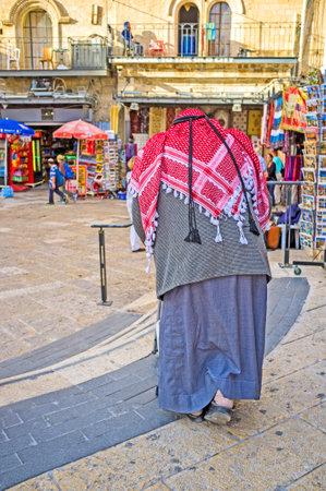 omar: JERUSALEM, ISRAEL - FEBRUARY 18, 2016: The senior Palestinian in red kufiya slowely walks with the walker in Omar Ben el-Hatab street, on February 18 in Jerusalem. Editorial