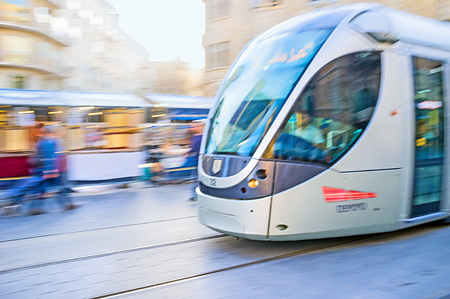 yafo: JERUSALEM, ISRAEL - FEBRUARY 18, 2016: The tram in motion,  riding along the Yafo Road, on February 18 in Jerusalem.
