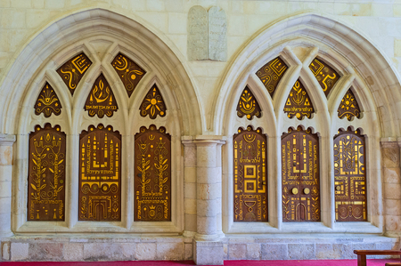 synagogues: JERUSALEM, ISRAEL - FEBRUARY 18, 2016: The double ark in the eastern wall of the Yohanan Ben Zakkai Synagogue, of Four Sephardic Synagogues complex, decorated with golden patterns and inscriptions, on February 18 in Jerusalem. Editorial