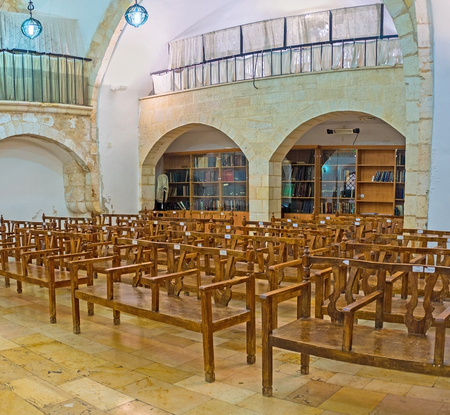 sephardic: JERUSALEM, ISRAEL - FEBRUARY 18, 2016: The interior of Eliyahu Hanavi synagogue with the book shelves on the background, Four Sephardic Synagogues complex, on February 18 in Jerusalem. Editorial