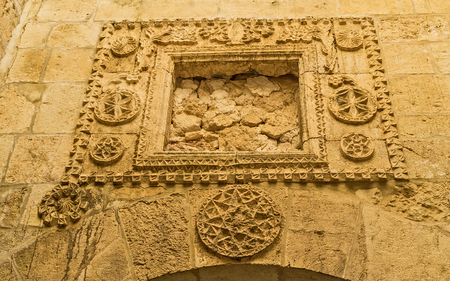 synagogues: JERUSALEM, ISRAEL - FEBRUARY 18, 2016: The preserved medieval stone carving in corridor of Four Sephardic Synagogues complex, on February 18 in Jerusalem. Editorial