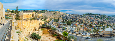 hasid: JERUSALEM, ISRAEL - FEBRUARY 18, 2016: The panoramic view on the hilly streets of the city, its ramparts, Mosques on the Temple Mount, cemetery on the Olive Mount, on February 18 in Jerusalem.