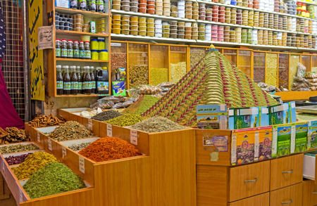 souq: JERUSALEM, ISRAEL - FEBRUARY 18, 2016: The interior of the spice shop in Muslim Quarter market with the masterpiece pyramid of spices, topped with the small figurine of the Dome of the Rock, on February 18 in Jerusalem.