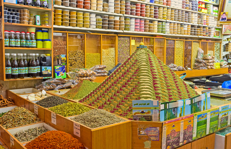 dome of the rock: JERUSALEM, ISRAEL - FEBRUARY 18, 2016: The pyramid of spices, topped with the small figurine of the Dome of the Rock is the best marketing decision of the spice shop in the old city, on February 18 in Jerusalem.