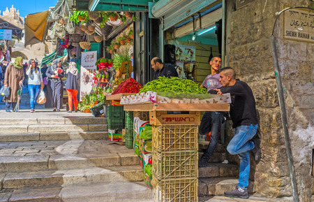 damascus: JERUSALEM, ISRAEL - FEBRUARY 18, 2016: The market stall in Bazaar at Damascus Gate offers the fresh fruits and vegetables, on February 18 in Jerusalem.