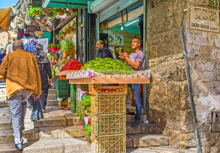 damascus: JERUSALEM, ISRAEL - FEBRUARY 18, 2016: The noisy merchants offers  fresh fruits and vegetables in Bazaar at Damascus Gate, on February 18 in Jerusalem. Editorial