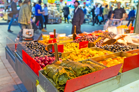 cuisines: JERUSALEM, ISRAEL - FEBRUARY 18, 2016: The Mahane Yehuda market offers various marinated olives, canned grape leaves, pickled peppers and other local cuisines, on February 18 in Jerusalem.