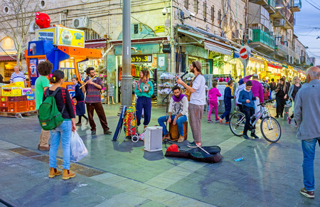 JERUSALEM, ISRAEL - FEBRUARY 18, 2016: The street musicians sing at the entrance of Mahane Yehuda market, on February 18 in Jerusalem.
