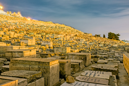 jewish houses: JERUSALEM, ISRAEL - FEBRUARY 18, 2016: The evening view of the medieval Jewish cemetery on the Mount of Olives, on February 18 in Jerusalem.
