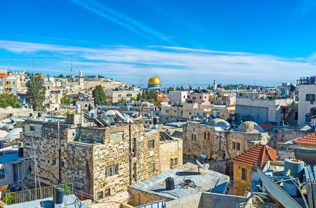 dome of the rock: The maze of the old city with the bright golden cupola of the Dome of the Rock in the middle, Jerusalem, Israel.