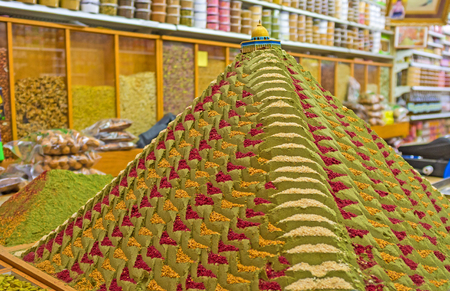 souq: The pyramid made of colorful spices with the figure of the Dome of the Rock decorates the old spice shop in Muslim Quarter of Jerusalem, Israel.