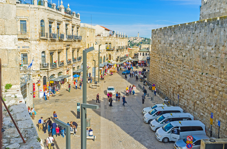 main market: JERUSALEM, ISRAEL - FEBRUARY 18, 2016: The view from the city ramparts on the tourist neighborhood and the main market street, on February 18 in Jerusalem.