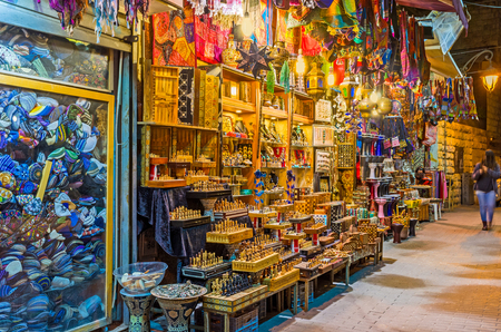 judaical: The souvenir stall in Ben Yehuda street offers the handmade wooden chess, arabian lights, colorful bags and other tourist goods, Jerusalem, Israel.