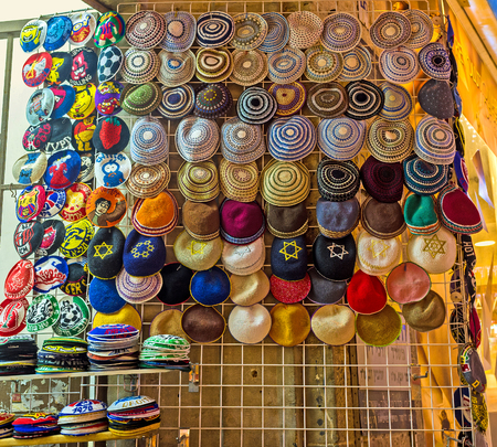 judaical: The wide range of the Jewish skullcaps with Davids stars, images, patterns and other decorations in the souvenir store in Ben Yehuda street, Jerusalem, Israel.