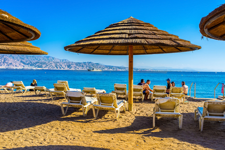 chaise lounge: EILAT, ISRAEL - FEBRUARY 23, 2016: The beache of Eilat are very comfortable, they are equipped by big beach umbrellas and soft beach chaise lounge, on February 23 in Eilat. Editorial