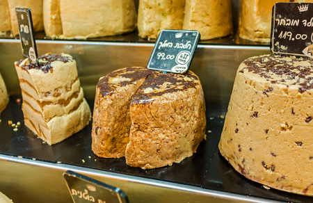 souq: JERUSALEM, ISRAEL - FEBRUARY 17, 2016: The heads of tasty halva sprinkled with chocolate chips, on February 17 in Jerusalem.