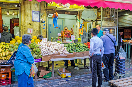 hasid: JERUSALEM, ISRAEL - FEBRUARY 17, 2016: The stall in Mahane Yehuda market with the fresh vegetables and fruits, on February 17 in Jerusalem.
