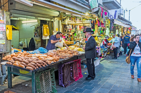 hasid: JERUSALEM, ISRAEL - FEBRUARY 17, 2016: The bakers stall in Mahane Yehuda market offers fresh, tasty and flavoured bread, on February 17 in Jerusalem.