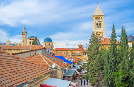 synagogues: The old city consists of the old stone buildings with the tiled roofs, numerous churches, mosques and synagogues, Jerusalem, Israel.