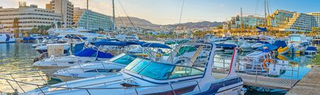 eilat: EILAT, ISRAEL - FEBRUARY 23, 2016: The moored motor boats slowly bob on the waves in Lagoona, on February 23 in Eilat.