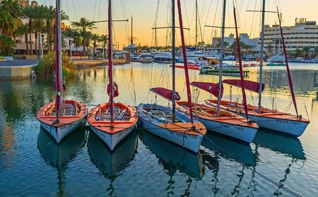 eilat: EILAT, ISRAEL - FEBRUARY 23, 2016: The small sailing yachts are dancing on the waves in Lagoona, on February 23 in Eilat.